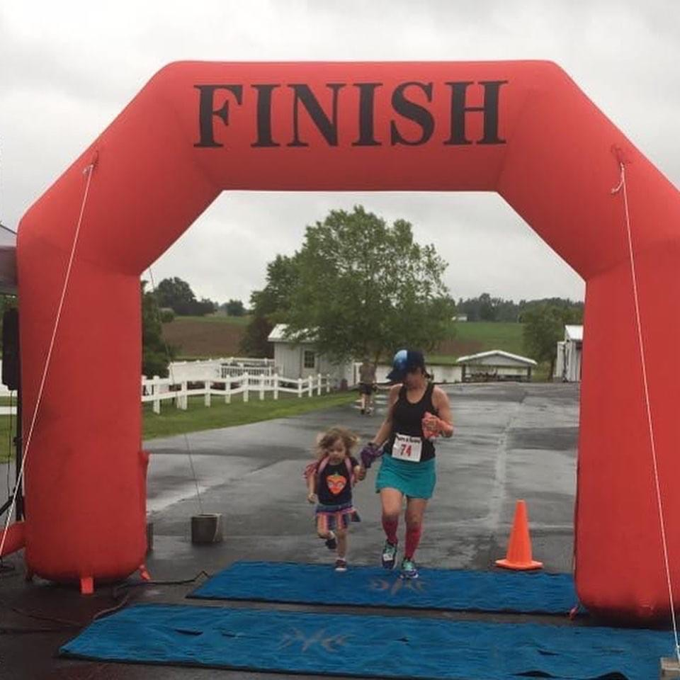 Crossing finish line with child
